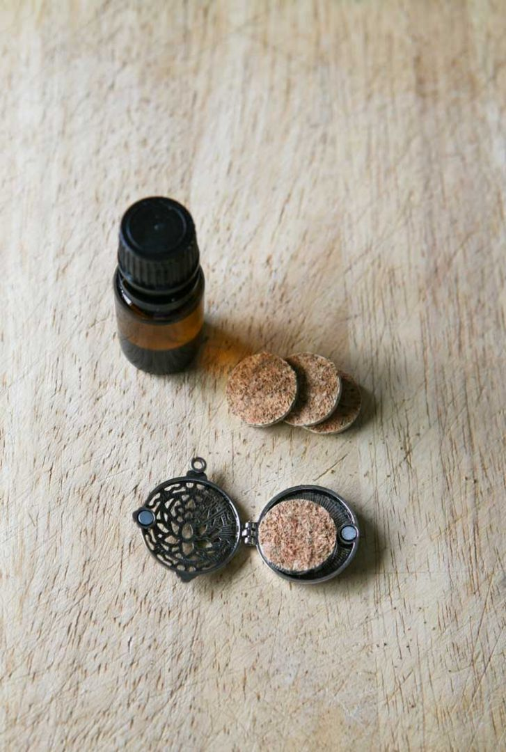 add essential oil to cork pad, insert into pendant