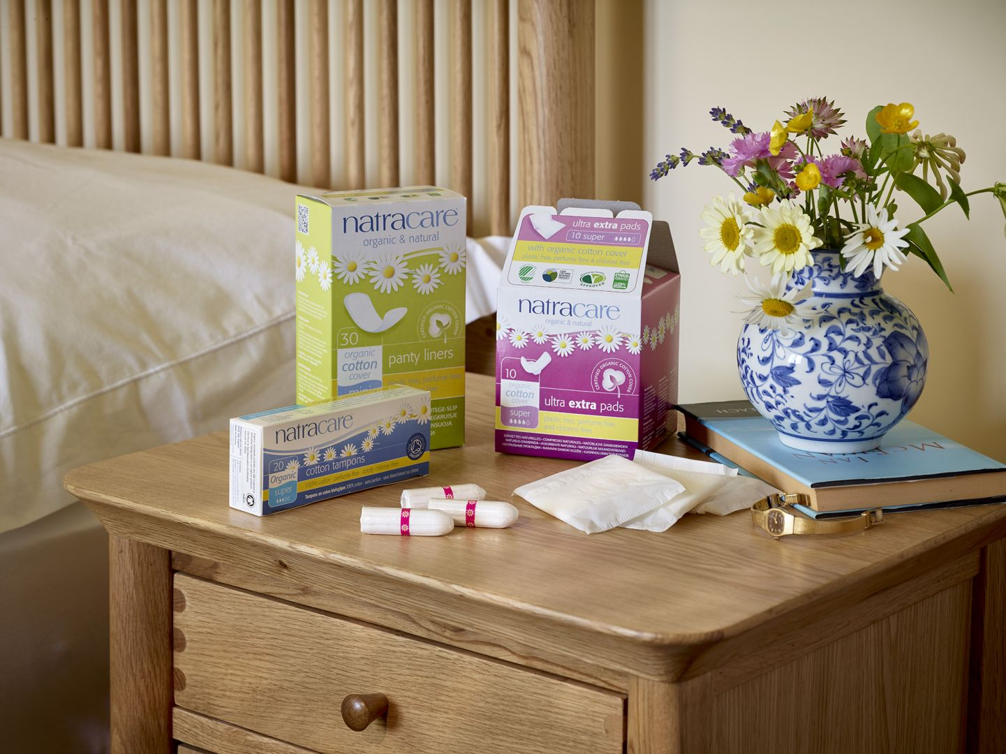 eco-friendly period options: natracare products on bedside table