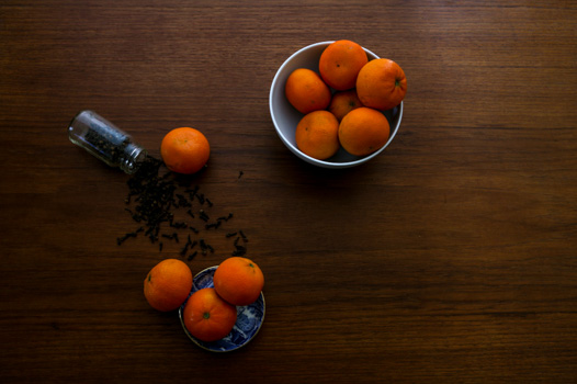 cloves and tangerines on a table