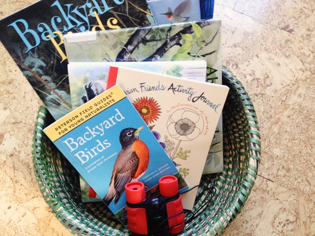 Gather some bird books into a handy basket