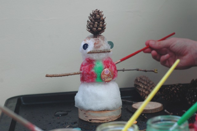 Use watercolour paint to personalize your mini snow person