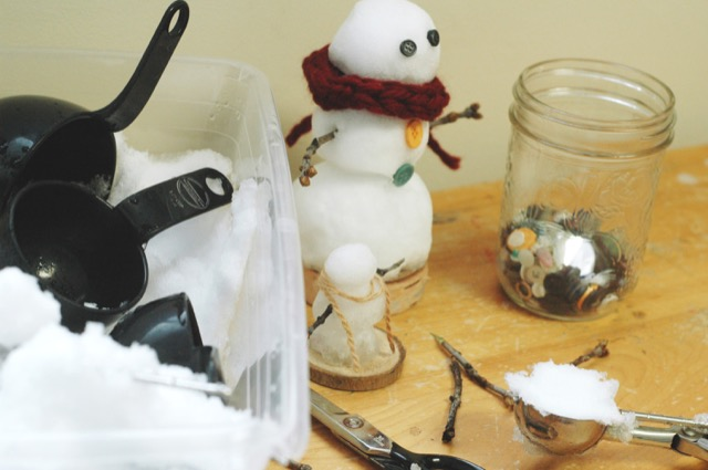 make a mini snow person using snow, sticks, string and more