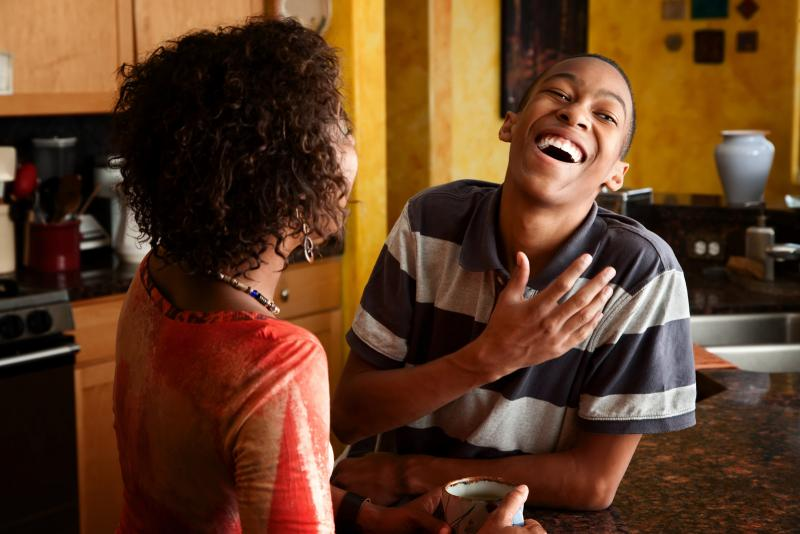 young black man laughing with his mother