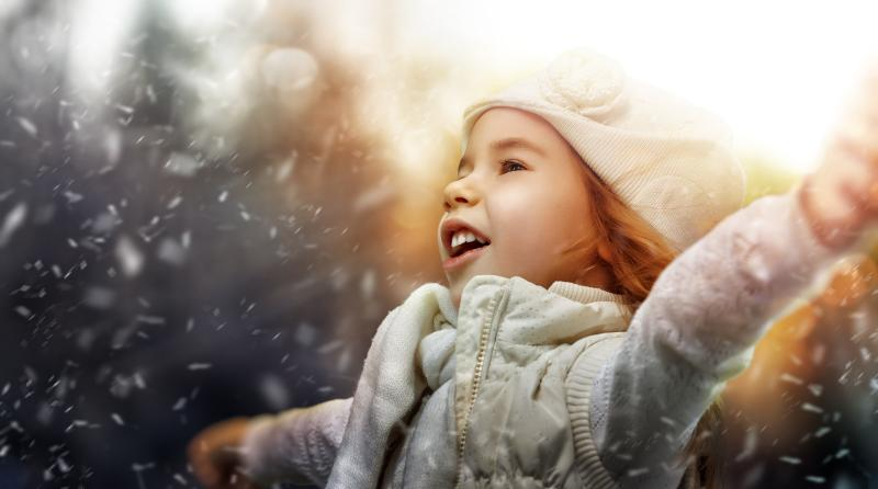 little girl delighted about falling snow