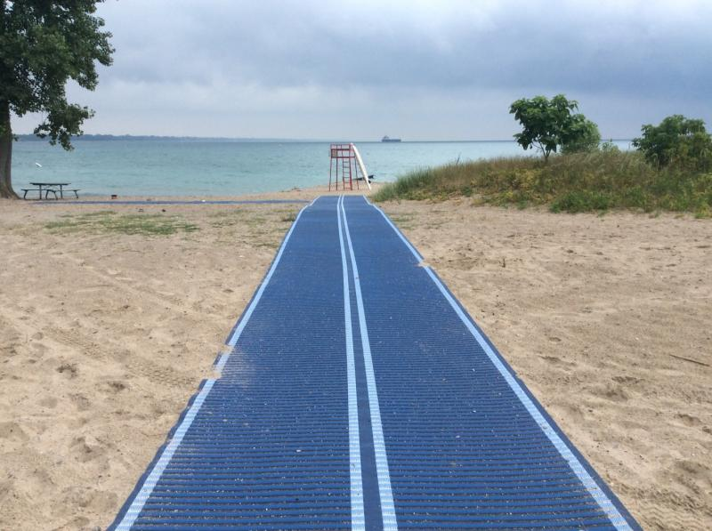 wheelchair mobility mat laid out on a beach