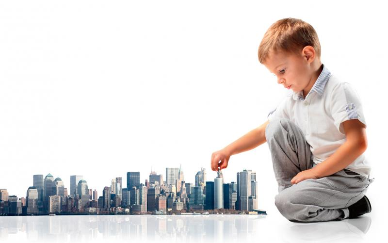 young boy playing with tiny city