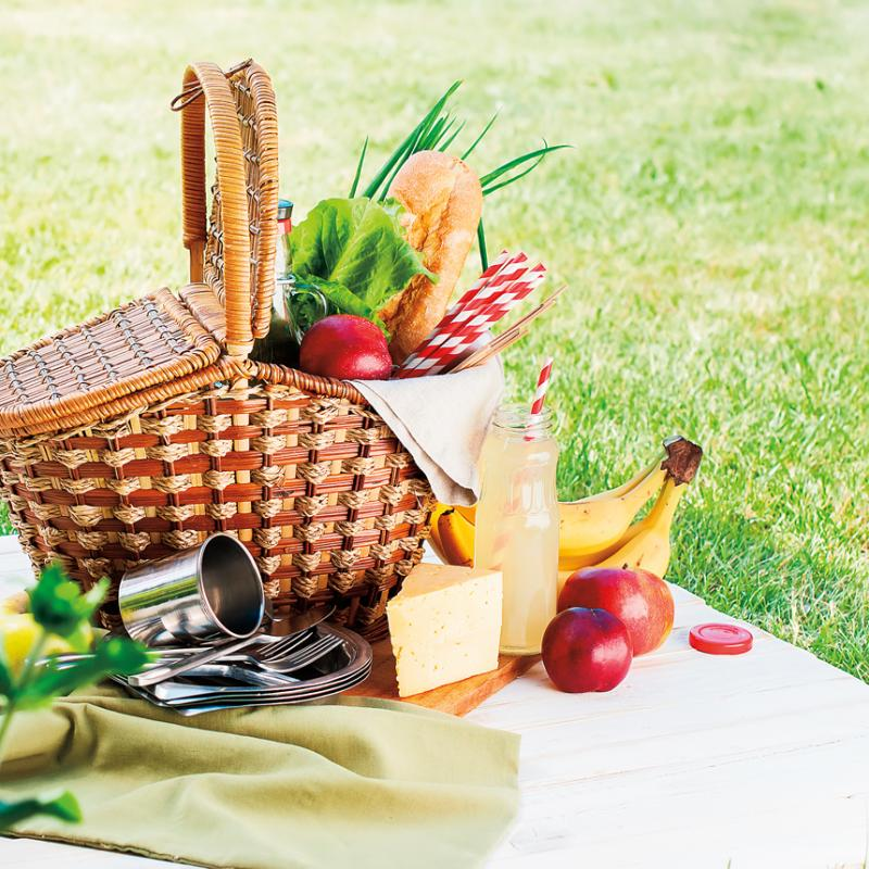 picnic basket with stainless steel dishes and lots of fresh food
