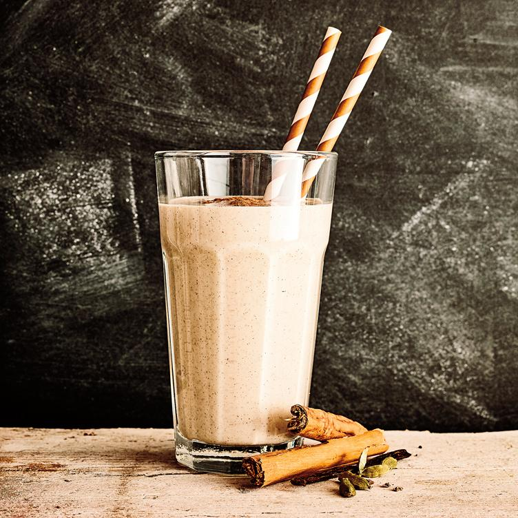 Malted Maca Smoothie in a glass with two straws