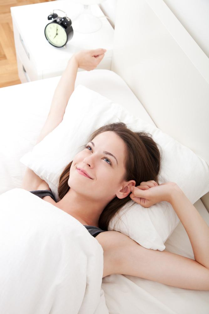 woman waking up feeling well rested