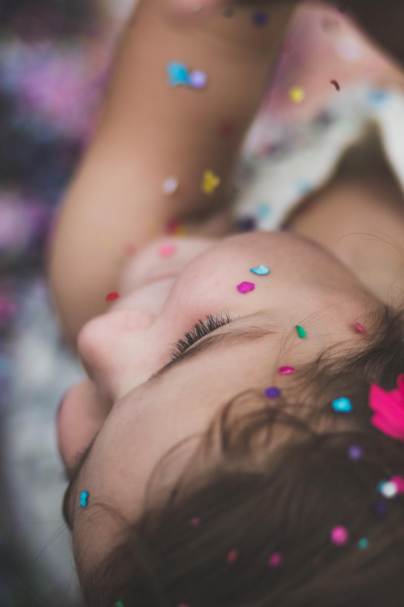 young girl covered in candy sprinkles