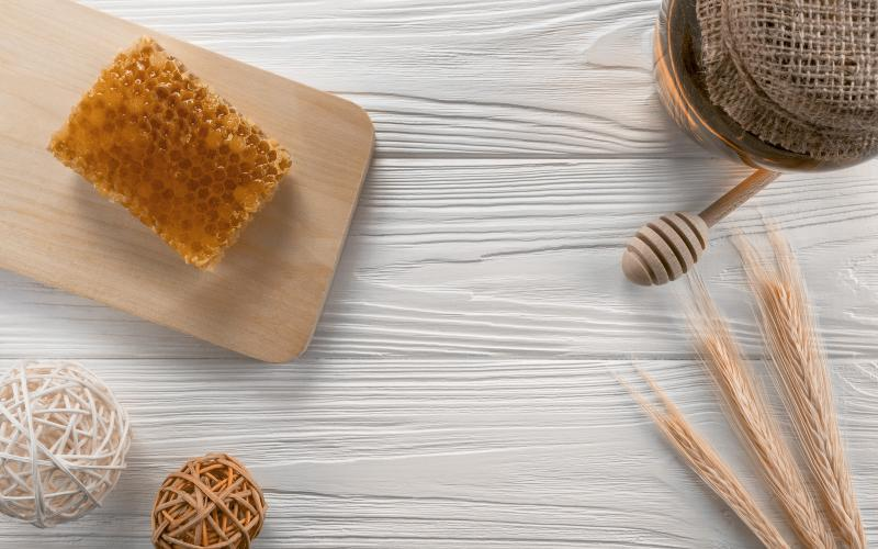 a honeycomb on a white wooden background