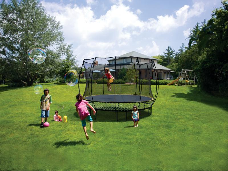 kids jumping on a springfree trampoline