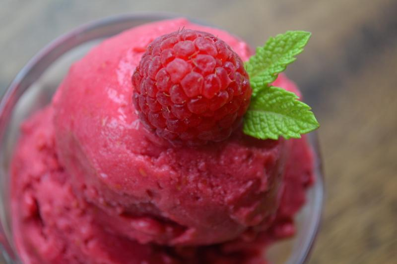 fruit ice cream with a raspberry on top