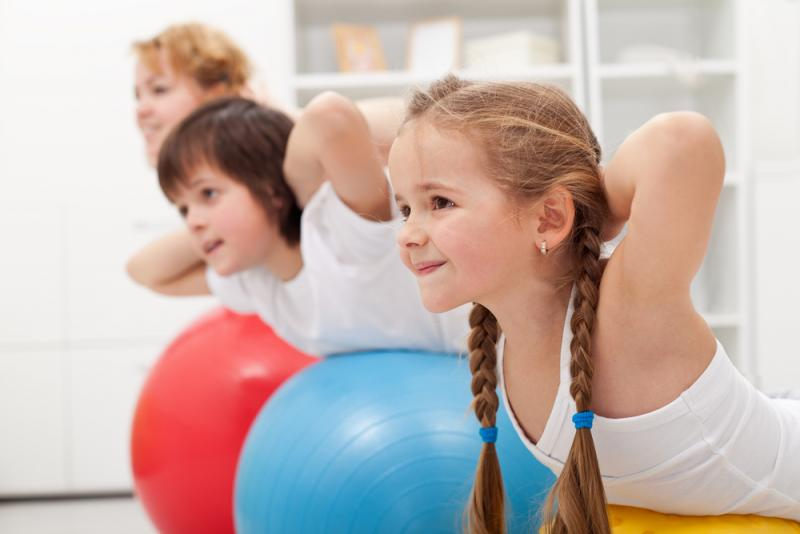 kids working out with exercise balls