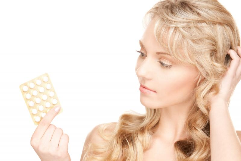 woman looking puzzled about birth control pills