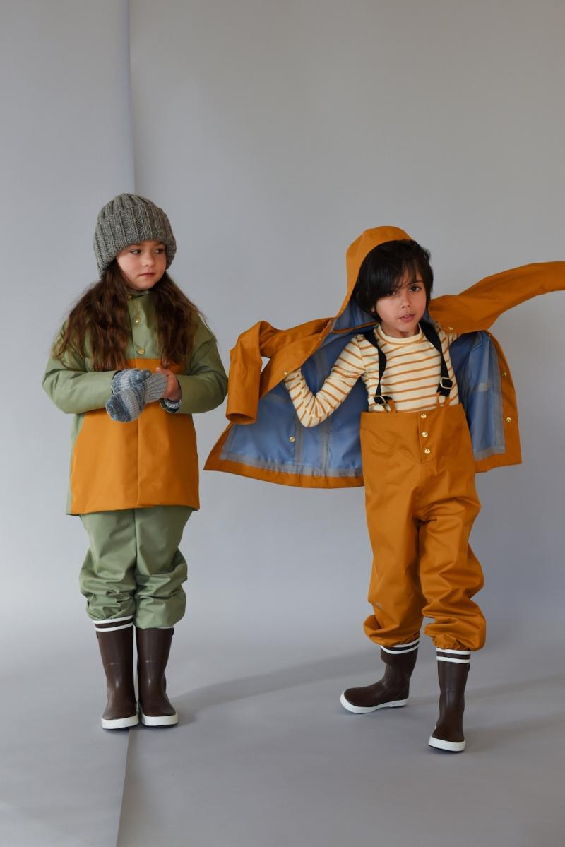 girl and boy wearing Faire Child anorak