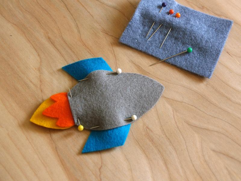felt rocket pieces pinned together