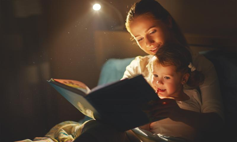 mom reading to child at night