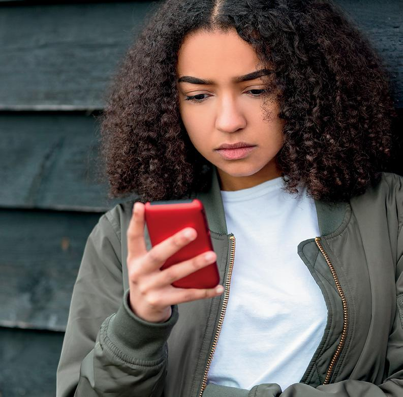 teen looking at red cell phone