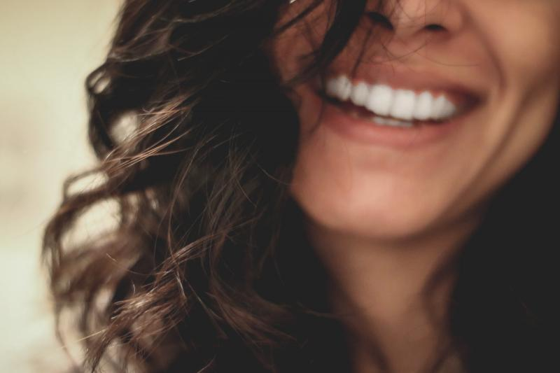 Smiling woman with healthy skin