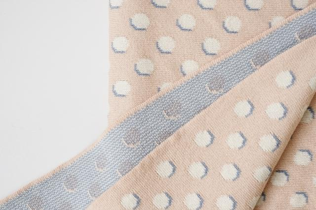 detail view of Echoview Fiber Mill blanket, pink with white polka dots