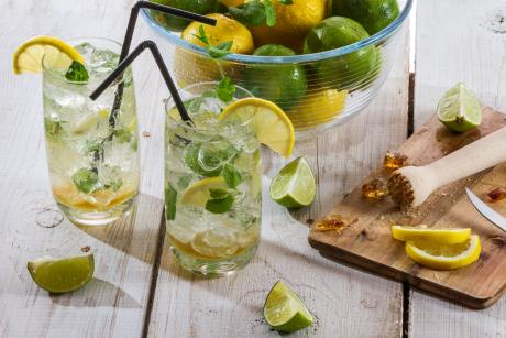glasses of water with lemon and limes