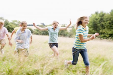 kids running through tall grass