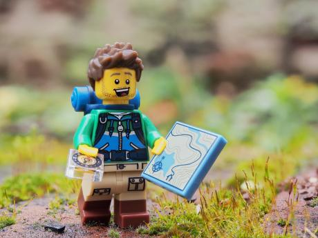 lego figure wearing orienteering gear
