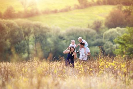family walking through a wildflower field