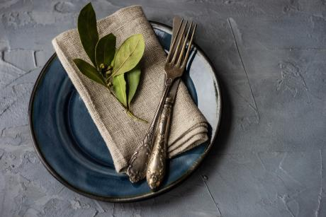 plate with napkin fork and leaves on top