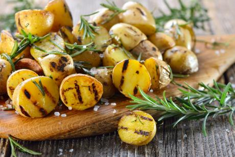 grilled potatoes with rosemary sprigs