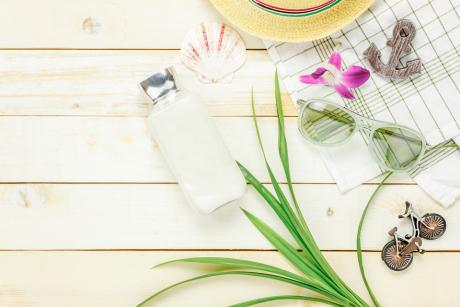 assorted summer items on a white wooden background