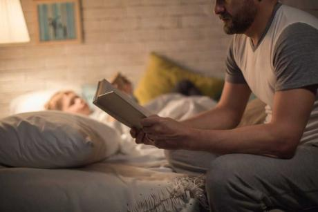father reading to child at bedtime