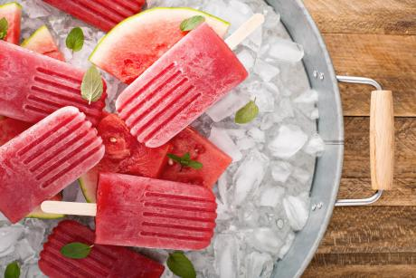 watermelon popsicles in a bucket of ice