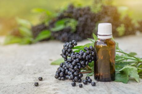elderberry berries and an elderberry syrup