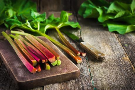 a bunch of fresh rhubarb on a cutting board