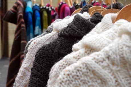 wool sweaters on hangers