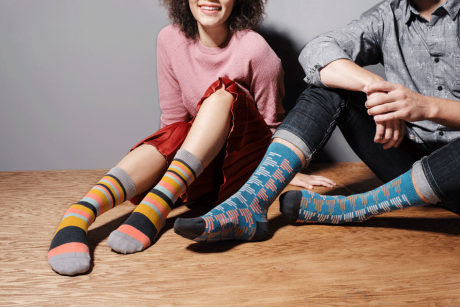 two kids sitting and wearing colourful socks